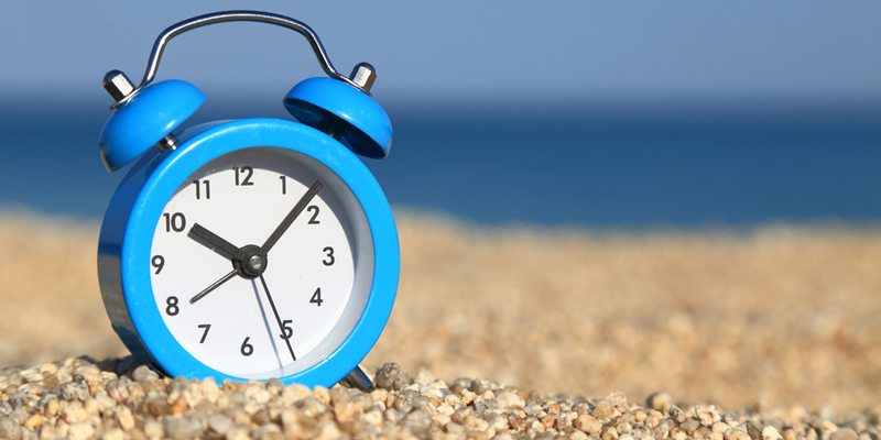 Reloj en la playa